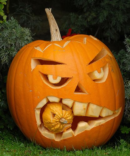 Jack o Lantern eating another pumpkin